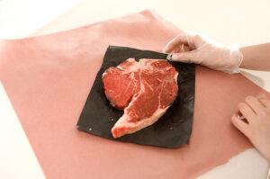 Meat Still In Package Being Held 531x800